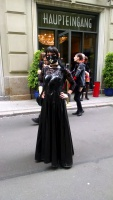 Long Lacquer Dress and Latex Mask in public