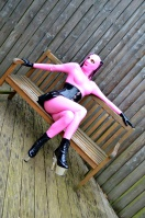 Pink Latexdoll relaxing in Spa