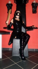 Mistress Kitty in dominatrix studio