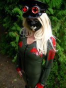 Blonde Mistress in Latex Uniform