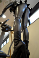 Heavy Rubber Latexdoll doing sports in the gym