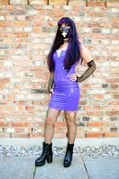 Outdoor in purple latexdress and fishnet stockings