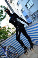 Black Latex Doll in Heavy Rubber on balcony
