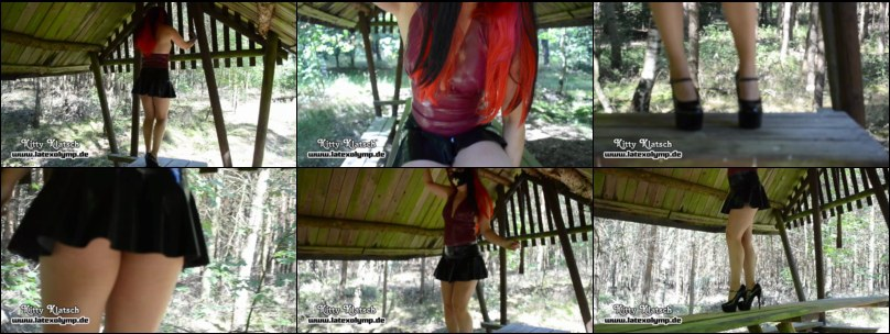Hot Latex Girl in short Skirt in a forest hut