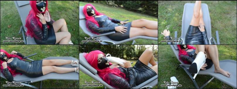 In Latex dress an white High Heels on the lounger