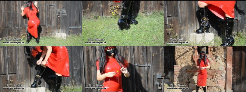 Kitty in red long latex dress outdoor